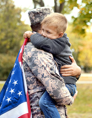 soldier hugging child