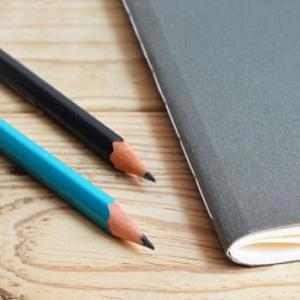 Photo of notebook and two pencils