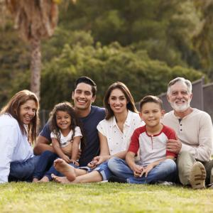 Hispanic family smiling in a park