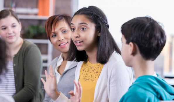 Teens talking in a school setting