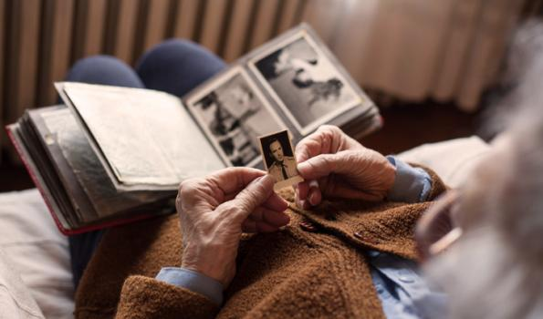 Older person looking at a photo album