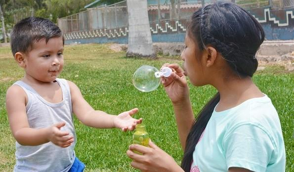 girl-blowing-bubbles-595x350